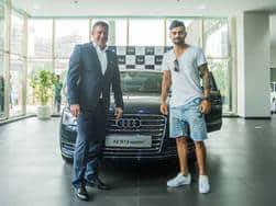 Virat Kohli picks up a brand new Audi A8L for himself, keys handed over by Joe King, Head Audi India