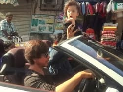 Video: Shah Rukh Khan seen zipping around in Mumbai with his son AbRam in his BMW 6-series convertible