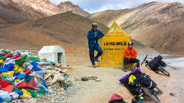 Ladakh_Two-cyclist-standing-on-mountains-road