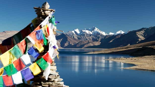 Tso-Moriri-Lake-with-prayer-flags---Ladakh---Jammu-and-Kashmir---India