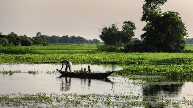 Father-and-son-in-a-boat-in-Majuli
