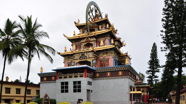 Golden statue of Gautam Buddha in Monastery in Bylakuppe