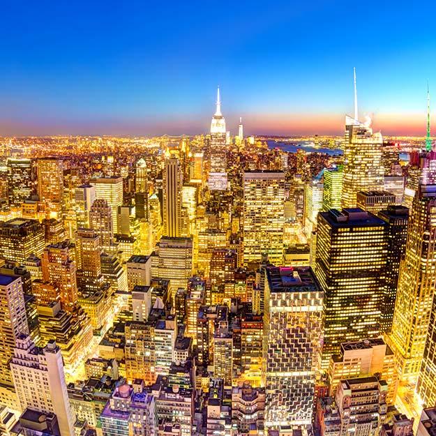 Empire State Building in an illuminated Manhattan downtown skyline