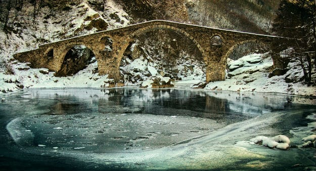 Old stone bridge in Bulgaria during the winter