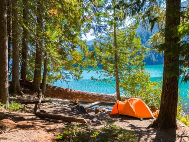 Majestic mountain Cheakamus turquoise water lake in Canada with campsite and orange tent