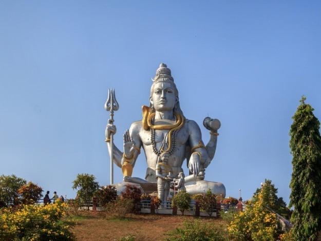 Statue of Lord Shiva in Murudeshwar, Karnataka, India. The demon Ravana gives Shiva lingam Ganesha in the form of the shepherd boy.