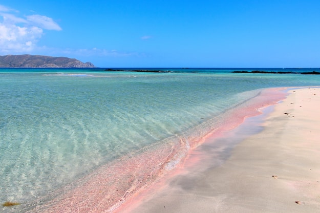 Pink sand beach of the famous Elafonisi off the coast of Crete island in Greece