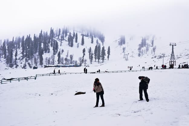Tourists take a photo at Gulmarg