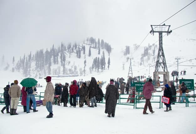 Tourists excitedly waiting to ride down Gulmarg's soft snowy slopes