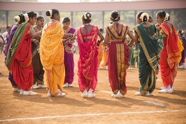 Unidentified girl students perform Lezim, a traditional folk dance, in Amravati, Maharashtra