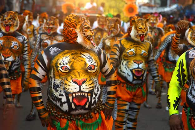 Body painted tiger dance artists perform in Thrissur