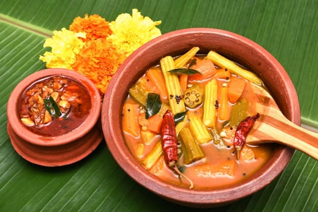 South Indian Sambar curry in earthen bowl served in a traditional Vishu sadhya