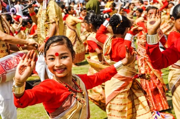 Dancing girl during performance at traditional Bihu festival in Guwahati, Assam