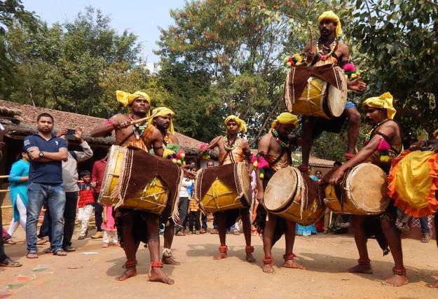 Artists perform Dollu kunitha in Makara Sankranti