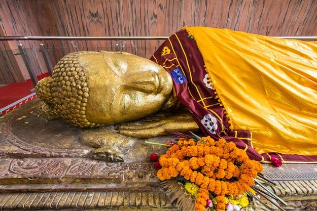 Reclining Buddha gold statue at the Mahaparinirvana Temple