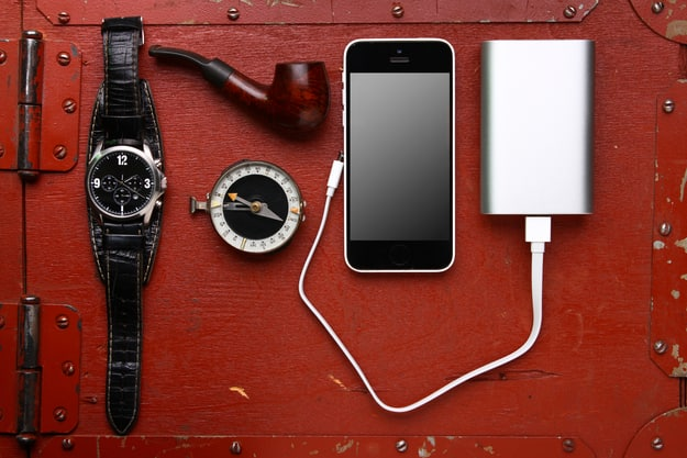 Power bank, phone, watch, compass and tobacco pipe