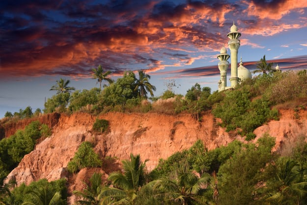 Mosque on top of red colored stones cliff in Varkala, Kerala