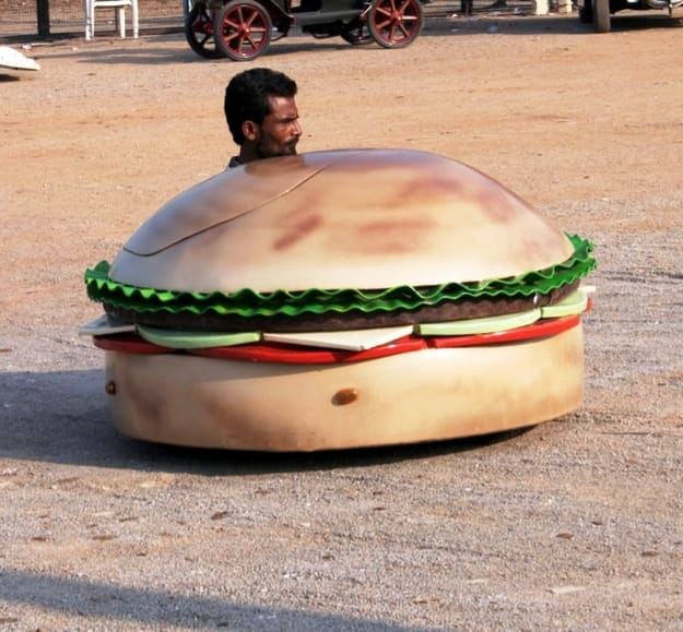 A burger-shaped car at the museum