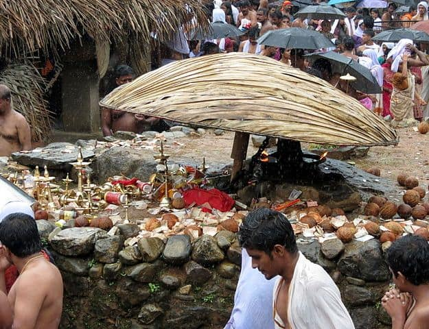 An idol with offerings around it at the festival, Photograph Courtesy: Sivavkm/Wikimedia Commons