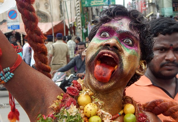 Devotee dressed and decorated as Pothuraju during Bonalu festival