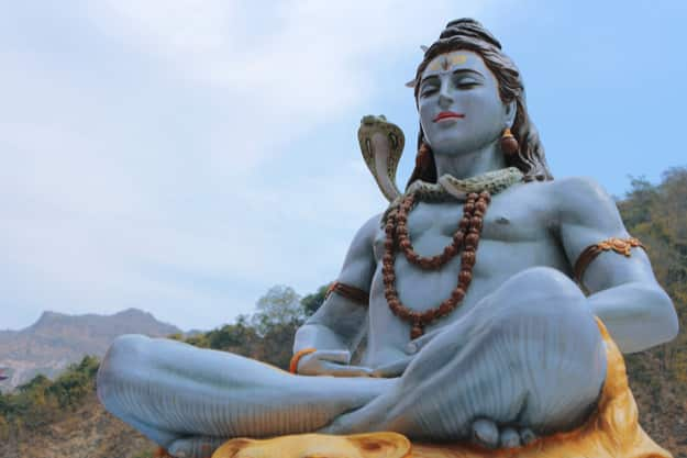 Beautiful statue of meditating Shiva near the Ganges River at the foot of the Himalayas in Rishikesh