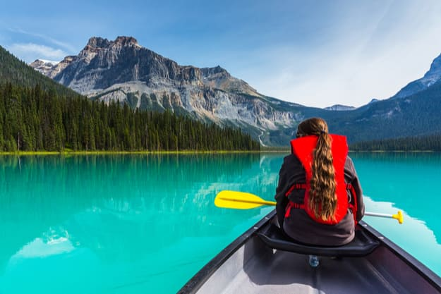 Canoeing on Emerald Lake in summer at the Yoho National Park, Alberta, Canada