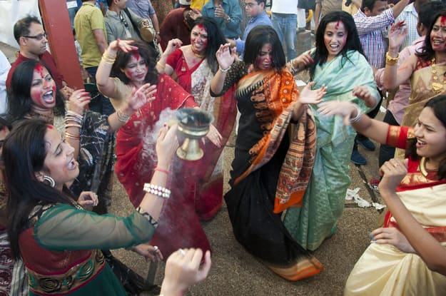 A group of Bengali women perform Dhunuchi Naach ritual during Durga Puja
