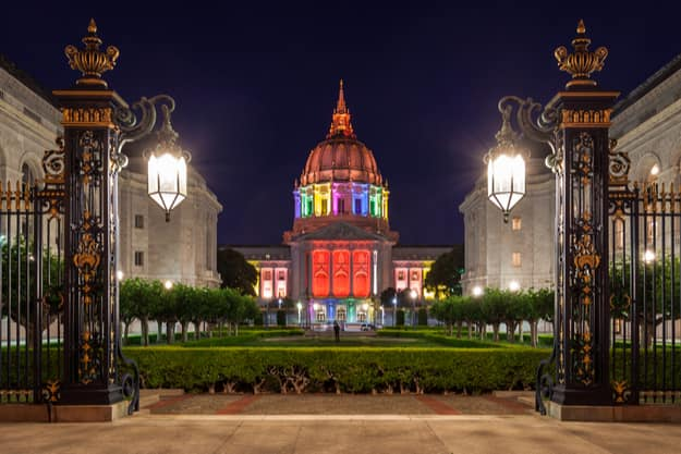 San Francisco City Hall illuminated in rainbow colors in honor of Pride Week