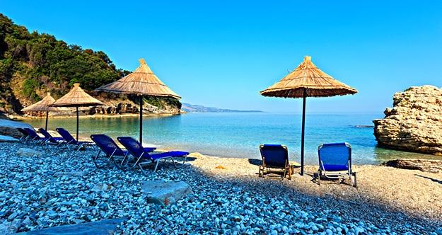 Albania beach with umbrellas