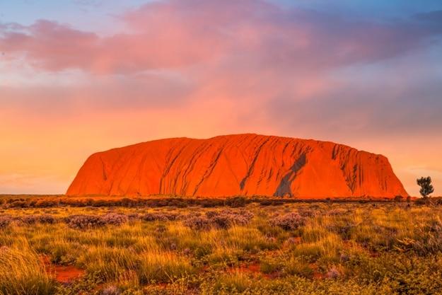 Uluru at sunset under colorful clouds,Uluru-Kata Tjuta National Park, Northern Territory, Australia