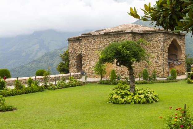 Unidentified people relax in the grounds of the Pari Mahal, a Mughal terraced garden palace on the banks of Dal Lake