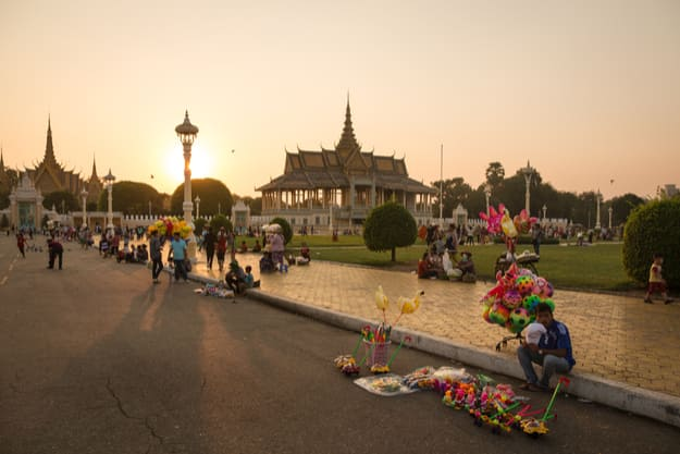 A man sells various toy in front of the Royal Palace in Phnom Penh