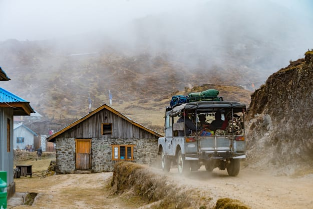 A tourist jeep passes through Singalila National Park. It is the route to Sankakphu and Phalut, the two highest peaks of Singalila range.