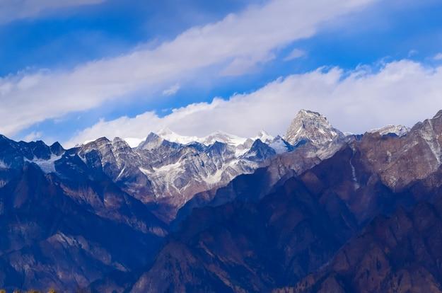 Mesmerizing view of Kamet, Parvati and Neelkanth mountains of Garhwal Himalayas from Kuari pass hiking trail near Auli, Uttrakhand