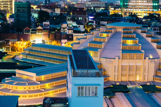 The evening colorful skyline with the Psar Thmei central market in Phnom Penh