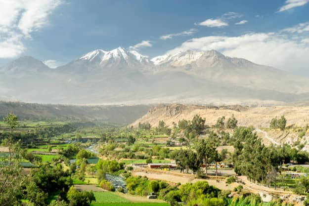 Chili river crossing Arequipa, Peru, with the Andes on the background