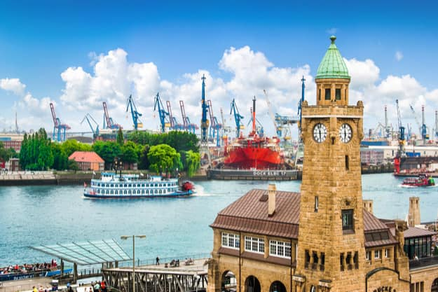 Beautiful view of famous Hamburger Landungsbruecken with harbor and traditional paddle steamer on Elbe river, St. Pauli district, Hamburg