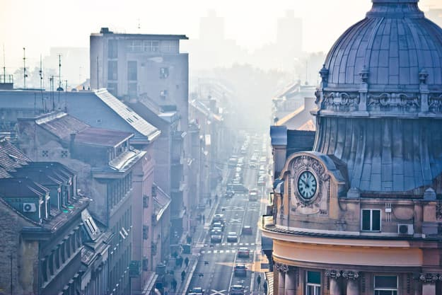 Busy Zagreb street in morning haze with old architecture aerial view