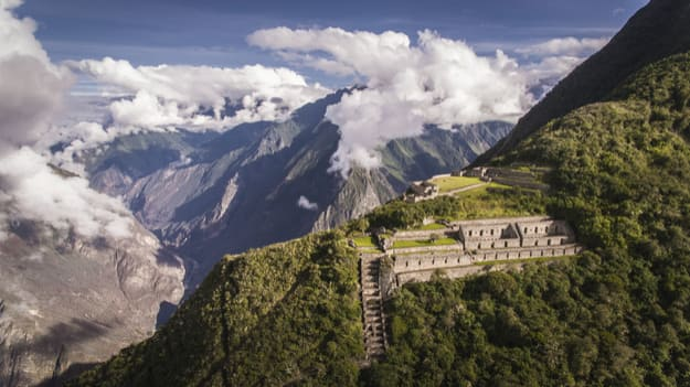 Choquequirao is an Incan site in south Peru, similar in structure and architecture to Machu Picchu. The ruins are buildings and terraces at levels above and below Sunch'u Pata, the truncated hill top