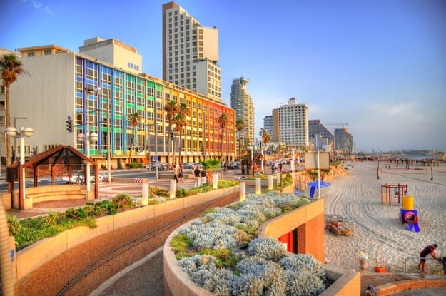 Colorful HDR image of Tel Aviv beach with some of its famous hotels (Mediterranean sea