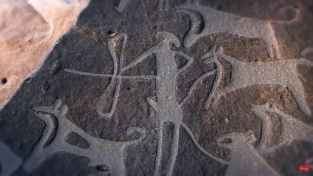 Dog rock art in Saudi Arabia, Photograph Courtesy:  Science Magazine/YouTube