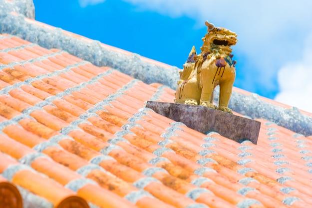 Okinawa Ryukyu style roof with a sculpture of Shasa mythical lion dog