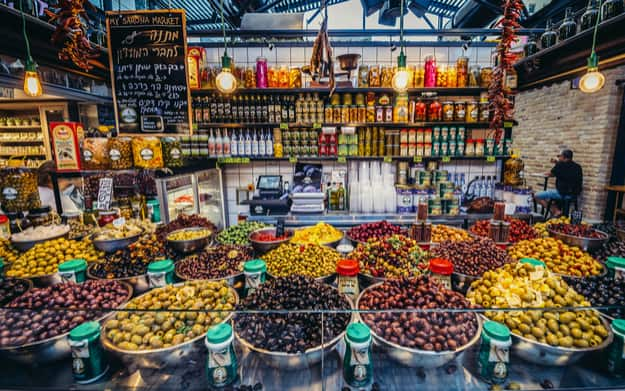 Olives for sale at pupular covered public market called Sarona Market in Tel Aviv