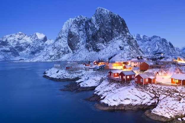 Traditional Norwegian fisherman's cabins, rorbuer, on the island of Hamnoy, Reine on the Lofoten in northern Norway. Photographed at dawn in winter