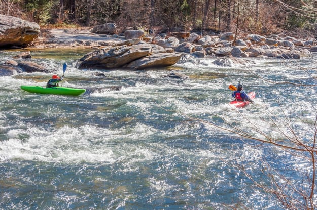 Unidentified kayakers, navigating rapids on the Chattooga Wild and Scenic River