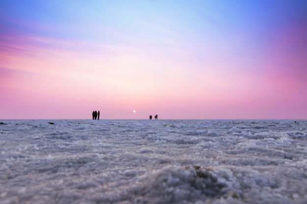 Beautiful multicolored sunset landscape silhouette of the Great Rann of Kutch, Gujarat