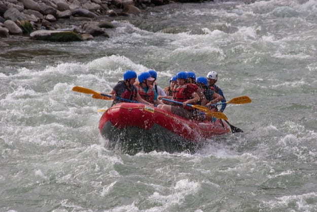 A group of people rafting in the waters of the Canete river in Lunahuana, Lima, Peru