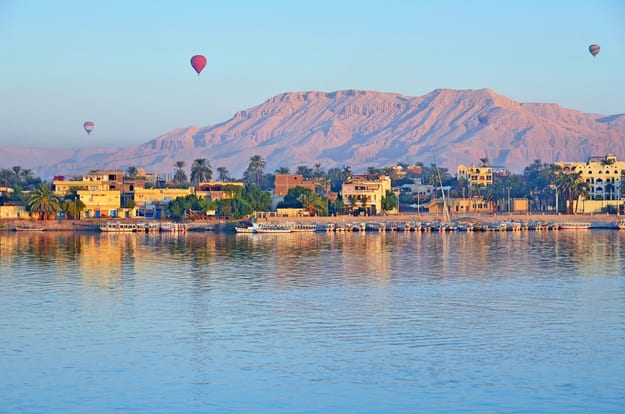 Balloons above Luxor, Egypt at dawn