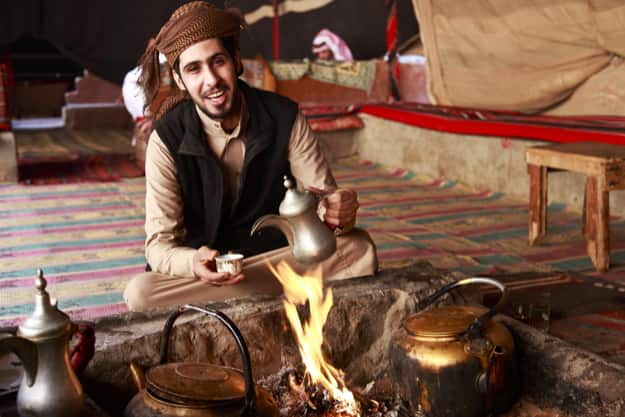 Bedouin man serving Arabic coffee in Wadi Rum,