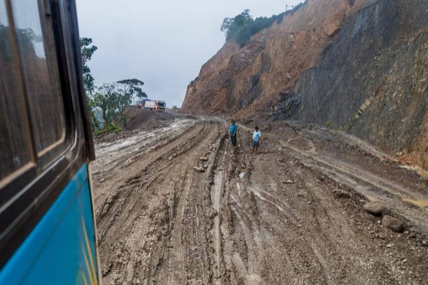 Bus on a muddy road in Yungas mountains, Bolivia